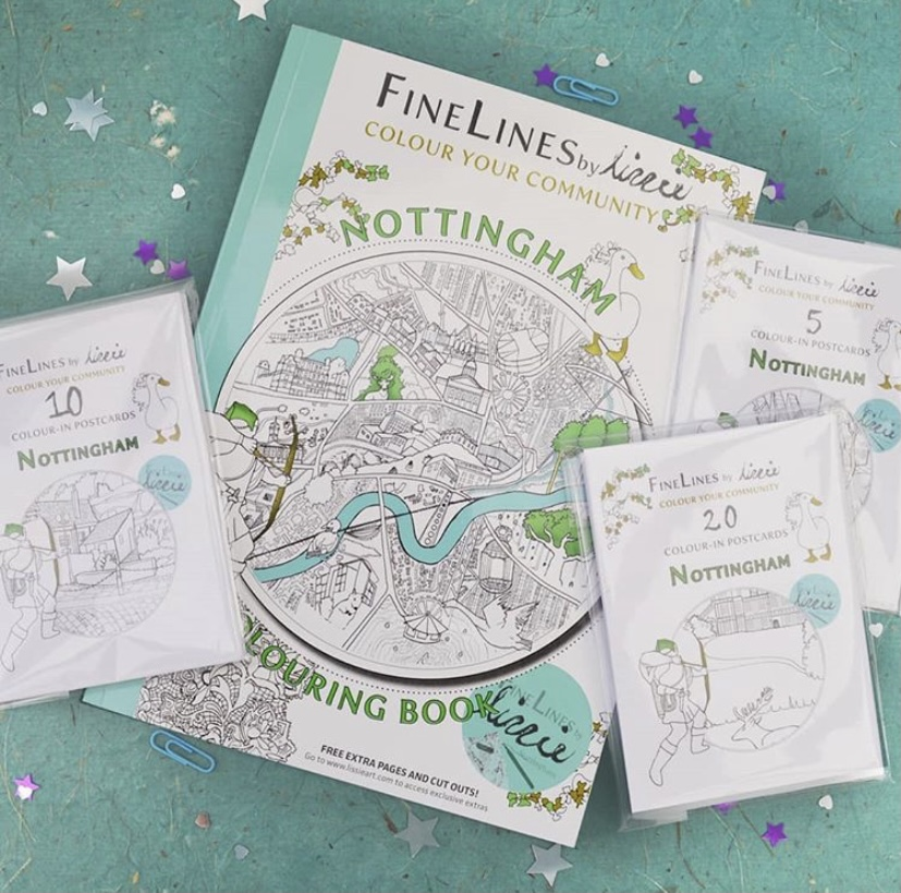 Colouring book and postcard packs laid on a starry background.