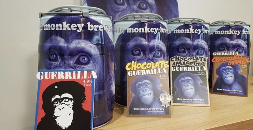 Mini kegs of beers with brightly coloured labels with chimpanzees on.