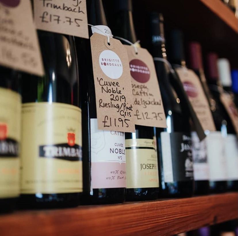 Wine bottles on a shelf.
