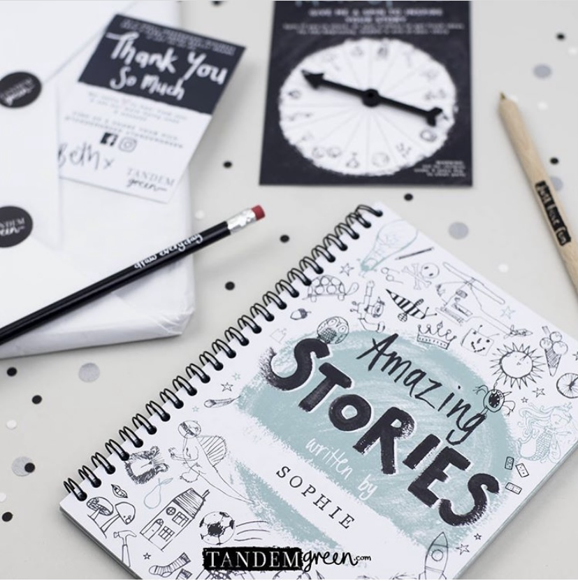 Stories book, spinner and stationery on a tabletop.