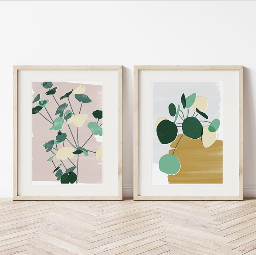 Two framed prints against a light coloured wall.